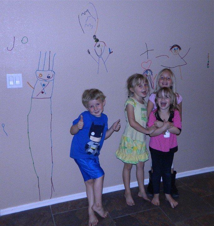 Four kids decorating with Wikki Stix