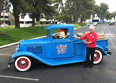 The real Wikki Stix Fun Truck (a 1934 Ford pickup truck) with Kem Clark, President of The Wikki Stix Co., and its cartoon driver Andy!